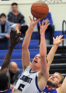 Longmont's Josh Cogdill reaches for the ball against Centaurus' Shane Ellington during Friday's game at Longmont.  For more photos please see www.dailycamera.com January 26, 2012 staff photo/ David R. Jennings