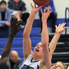"Longmont's Josh Cogdill reaches for the ball against Centaurus' Shane Ellington during Friday's game at Longmont. <br /> For more photos please see  <a href=""http://www.dailycamera.com"">http://www.dailycamera.com</a><br /> January 26, 2012<br /> staff photo/ David R. Jennings"