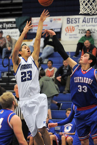 Longmont's Brian Donaire shoots the ball over Centaurus' Austin Tunquist during Friday's game at Longmont.  For more photos please see www.dailycamera.com January 26, 2012 staff photo/ David R. Jennings