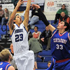 "Longmont's Brian Donaire shoots the ball over Centaurus' Austin Tunquist during Friday's game at Longmont. <br /> For more photos please see  <a href=""http://www.dailycamera.com"">http://www.dailycamera.com</a><br /> January 26, 2012<br /> staff photo/ David R. Jennings"