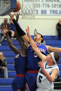 Centaurus' Austin Tunquist and Matu Giltner go to the basket past Longmont's Josh Cogdill during Friday's game at Longmont.  For more photos please see www.dailycamera.com January 26, 2012 staff photo/ David R. Jennings