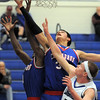 "Centaurus' Austin Tunquist and Matu Giltner go to the basket past Longmont's Josh Cogdill during Friday's game at Longmont. <br /> For more photos please see  <a href=""http://www.dailycamera.com"">http://www.dailycamera.com</a><br /> January 26, 2012<br /> staff photo/ David R. Jennings"