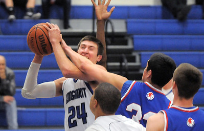 Longmont's Reilly Mau fights for the ball with Centaurus' Austin Tunquist during Friday's game at Longmont.  For more photos please see www.dailycamera.com January 26, 2012 staff photo/ David R. Jennings