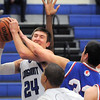 "Longmont's Reilly Mau fights for the ball with Centaurus' Austin Tunquist during Friday's game at Longmont. <br /> For more photos please see  <a href=""http://www.dailycamera.com"">http://www.dailycamera.com</a><br /> January 26, 2012<br /> staff photo/ David R. Jennings"
