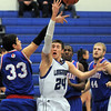 "Centaurus' Austin Tunquist knocks the ball from Longmont's Reilly Mau during Friday's game at Longmont. <br /> For more photos please see  <a href=""http://www.dailycamera.com"">http://www.dailycamera.com</a><br /> January 26, 2012<br /> staff photo/ David R. Jennings"