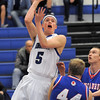 "Longmont's Josh Cogdill goes to the basket over Centaurus' Shane Ellingotn during Friday's game at Longmont. <br /> For more photos please see  <a href=""http://www.dailycamera.com"">http://www.dailycamera.com</a><br /> January 26, 2012<br /> staff photo/ David R. Jennings"