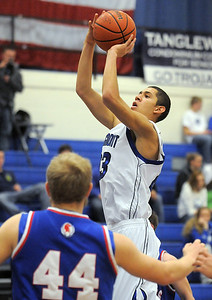 Longmont's Brian Donaire shoots the ball against Centaurus during Friday's game at Longmont.  For more photos please see www.dailycamera.com January 26, 2012 staff photo/ David R. Jennings