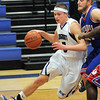 "Longmont's Josh Cogdill drives the ball past Centaurus' Shane Ellington during Friday's game at Longmont. <br /> For more photos please see  <a href=""http://www.dailycamera.com"">http://www.dailycamera.com</a><br /> January 26, 2012<br /> staff photo/ David R. Jennings"