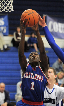 "Centaurus' Matu Giltner rebounds the ball against Longmont during Friday's game at Longmont. <br /> For more photos please see  <a href=""http://www.dailycamera.com"">http://www.dailycamera.com</a><br /> January 26, 2012<br /> staff photo/ David R. Jennings"