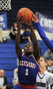 Centaurus' Matu Giltner rebounds the ball against Longmont during Friday's game at Longmont.  For more photos please see www.dailycamera.com January 26, 2012 staff photo/ David R. Jennings