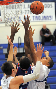 Longmont's Marcus Johnson rebounds the ball against Centaurus' Matu Giltner during Friday's game at Longmont.  For more photos please see www.dailycamera.com January 26, 2012 staff photo/ David R. Jennings