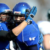 Longmont's Vince Johnson (right) is congratulated by CJ Franchini after scoring a touchdown against Pine Creek during the Class 4A State Quarterfinals at Longmont High School in Longmont, Saturday, Nov. 21, 2009.<br /> <br /> KASIA BROUSSALIAN /THE CAMERA