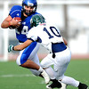 Longmont's Jake Johnson (14) is tackled by Pine Creek's Nick Markowski (10) during the Class 4A State Quarterfinals at Longmont High School in Longmont, Saturday, Nov. 21, 2009.<br /> <br /> KASIA BROUSSALIAN /THE CAMERA
