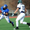Longmont's Braden Hitchcock (24) prepares for a tackle by Pine Creek's Nick Markowski (10) during the Class 4A State Quarterfinals at Longmont High School in Longmont, Saturday, Nov. 21, 2009.<br /> <br /> KASIA BROUSSALIAN /THE CAMERA