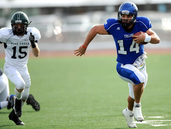 Longmont's Jake Johnson (14) runs the football as Pine Creek's Ben Molina (15) follows during the Class 4A State Quarterfinals at Longmont High School in Longmont, Saturday, Nov. 21, 2009.<br /> <br /> KASIA BROUSSALIAN /THE CAMERA