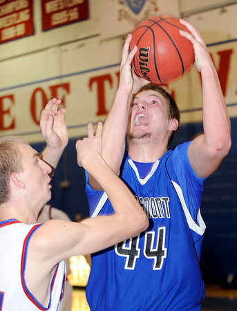 Longmont High School senior Justin Traxinger grabs a rebound during a basketball game against Centaurus High School on Friday, Jan. 28, in Lafayette. Longmont defeated Centaurus in double over  time.<br /> Photo by Jeremy Papasso