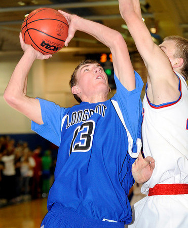 Longmont High School senior Cade Kloster shoots a two-pointer over a Centaurus defender during a basketball game against Centaurus High School on Friday, Jan. 28, in Lafayette. Longmont defeated Centaurus in double over  time.<br /> Photo by Jeremy Papasso