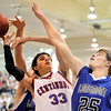 Centaurus High School junior Austin Tunquist gets his shot blocked by Longmont defenders during a basketball game on Friday, Jan. 28, in Lafayette. Longmont defeated Centaurus in double over  time.<br /> Photo by Jeremy Papasso