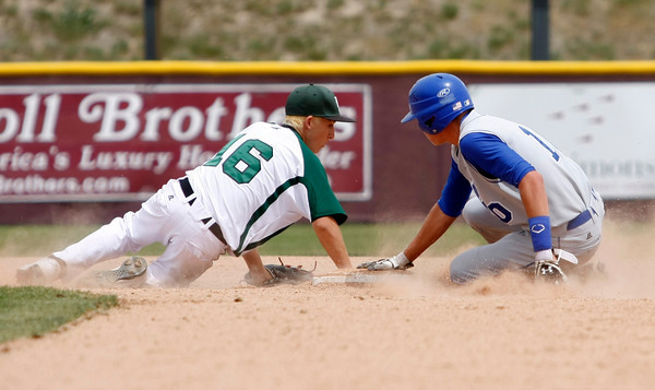 "Longmont's Andrew Bladt,#10, slides safe into second base before D'Evelyn's Ricki Swift,#16, can tag him out during the Longmont vs. D'Evelyn baseball game on  May, 18, 2012, Aurora.<br /> Photo by Derek Broussard<br /> For more photos visit  <a href=""http://www.dailycamera.com"">http://www.dailycamera.com</a>"