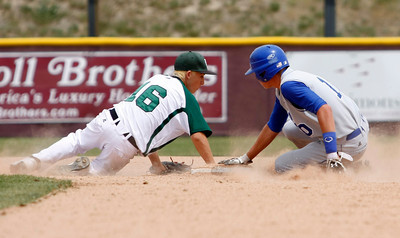 Longmont's Andrew Bladt,#10, slides safe into second base before D'Evelyn's Ricki Swift,#16, can tag him out during the Longmont vs. D'Evelyn baseball game on  May, 18, 2012, Aurora. Photo by Derek Broussard For more photos visit www.dailycamera.com