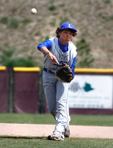 Longmont's Zach Zamudio, #12, throws the ball to first base during the Longmont vs. D'Evelyn baseball game on Friday, May, 18, 2012, Aurora. Photo by Derek Broussard For more photos visit www.dailycamera.com