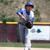 """Longmont's Zach Zamudio, #12, throws the ball to first base during the Longmont vs. D'Evelyn baseball game on Friday, May, 18, 2012, Aurora.<br /> Photo by Derek Broussard<br /> For more photos visit  <a href=""""http://www.dailycamera.com"""">http://www.dailycamera.com</a>"""