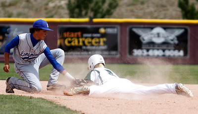 Longmont's Zach Zamudio, #12, tries to tag out  D'Evelyn's Luke Stratman, #2, during the Longmont vs. D'Evelyn baseball game on  May, 18, 2012, Aurora. Photo by Derek Broussard For more photos visit www.dailycamera.com