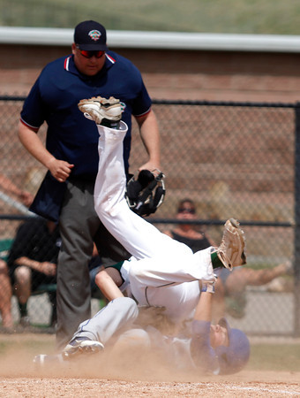 "Longmont's Travis Green, #4, collides into D'Evelyn's Chase Cleary, #6, at home base during the Longmont vs. D'Evelyn baseball game on  May, 18, 2012, Aurora.<br /> Photo by Derek Broussard<br /> For more photos visit  <a href=""http://www.dailycamera.com"">http://www.dailycamera.com</a>"