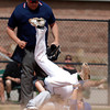 """Longmont's Travis Green, #4, collides into D'Evelyn's Chase Cleary, #6, at home base during the Longmont vs. D'Evelyn baseball game on  May, 18, 2012, Aurora.<br /> Photo by Derek Broussard<br /> For more photos visit  <a href=""""http://www.dailycamera.com"""">http://www.dailycamera.com</a>"""