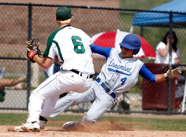 "Longmont's Travis Green,#4, slides into home base as D'Evelyn's Chase Cleary,#6, guards the plate during the Longmont vs. D'Evelyn baseball game on  May, 18, 2012, Aurora.<br /> Photo by Derek Broussard<br /> For more photos visit  <a href=""http://www.dailycamera.com"">http://www.dailycamera.com</a>"