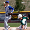"""Longmont's Will Amen, #16,tags out  D'Evelyn'sRyan Matheson, #17, at second base during the Longmont vs. D'Evelyn baseball game on  May, 18, 2012, Aurora.<br /> Photo by Derek Broussard<br /> For more photos visit  <a href=""""http://www.dailycamera.com"""">http://www.dailycamera.com</a>"""