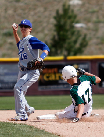 "Longmont's Will Amen, #16,tags out  D'Evelyn'sRyan Matheson, #17, at second base during the Longmont vs. D'Evelyn baseball game on  May, 18, 2012, Aurora.<br /> Photo by Derek Broussard<br /> For more photos visit  <a href=""http://www.dailycamera.com"">http://www.dailycamera.com</a>"