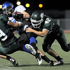 """Longmont High School junior D.J. Fowler gets tackled by Niwot senior Xandon Sigafoos, No. 9, and junior Nick Stager, No. 42, during a football game on Thursday, Oct. 8, at Longmont High School.<br /> For more photos go to  <a href=""""http://www.dailycamera.com"""">http://www.dailycamera.com</a><br /> Photo by Jeremy Papasso"""