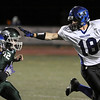 """Longmont High School senior Merrill Mikal gives a stiff arm to Niwot defender Nick Stager while running the ball in the football game on Thursday, Oct. 8, at Longmont High School.<br /> For more photos go to  <a href=""""http://www.dailycamera.com"""">http://www.dailycamera.com</a><br /> Photo by Jeremy Papasso"""