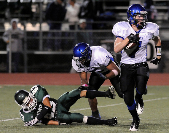 """Longmont High School junior D.J. Fowler returns a punt for a touchdown during a football game against Niwot High School on Thursday, Oct. 8, at Longmont High School.<br /> For more photos go to  <a href=""""http://www.dailycamera.com"""">http://www.dailycamera.com</a><br /> Photo by Jeremy Papasso"""