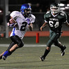 "Longmont High School senior Cameron Herbert runs for a long touchdown past Niwot junior Oscar Lopez in the third quarter of the football game on Thursday, Oct. 8, at Longmont High School.<br /> For more photos go to  <a href=""http://www.dailycamera.com"">http://www.dailycamera.com</a><br /> Photo by Jeremy Papasso"