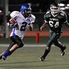 "Longmont High School senior Cameron Herbert runs for a long touchdown past Niwot junior Oscar Lopez in the third quarter of the football game on Thursday, Oct. 8, at Longmont High School.<br /> For more photos go to  <a href=""http://www.dailycamera.com"">http://www.dailycamera.com</a><br /> Photo by Jeremy Papasso"