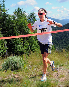 Morgan Arritola (#502), of Ketchum, Idaho, arrives at the finish line, to win The Loon Mountain race, which was held at Loon Mountain Resort, in Lincoln, NH, on July 8th, 2012. This year's race was also the Women's US Mountain Running team qualifier for the World Mountain Running Championships, to be held this September in Ponte di Legno, Italy. Ms. Arritola qualified for the US team, with a winning time of 46:16.