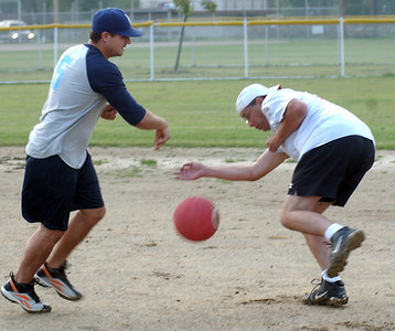 Brent Susanjar, left, of Little Lighthouse Sharks, throws out Shannon Green, of St. Lads team, running to second base, in co-ed kickball league at Oakwood Park Sep. 8.  Steve Manheim