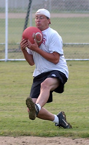 Shannon Green makes a running catch for an out for the St. Lads team in co-ed kickball league at Oakwood Park in Lorain Sep. 8.   Steve Manheim