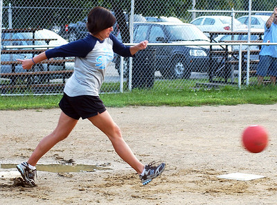 Rona Proudfoot kicks for a base hit for the Little Lighthouse Learning Center Sharks team in co-ed kickball league at Oakwood Park in Lorain Sep. 8.  Steve Manheim