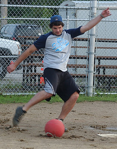 Justin Susanjar of Little Lighthouse Learning Center Sharks kicks the ball at co-ed kickball league at Oakwood Park Sep 8.  Steve Manheim
