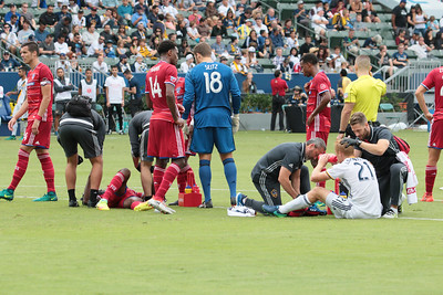After a nasty header, two players are down and get treated on the field.