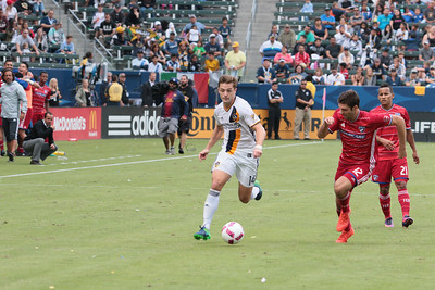 Robbie Rodgers of the L.A. Galaxy sprints up the wings looking for a cross.