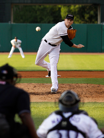 Louisville Bats pitcher Chad Reineke pitches during the third inning of their game against the Rochester Red Wings at Louisville Slugger Field in downtown Louisville on Friday night. Staff photo by Christopher Fryer