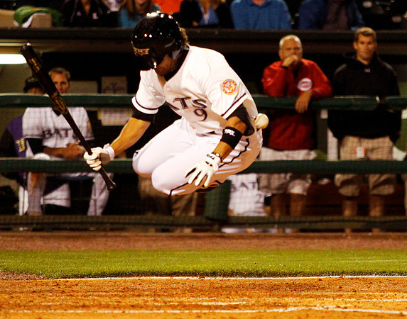 Louisville Bats infielder Kristopher Negron jumps to avoid a wild pitch during their game against the Columbus Clippers at Louisville Slugger Field on Friday night. Staff photo by Christopher Fryer