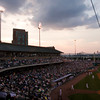 Fans watch from their seats as the Louisville Bats take on the Rochester Red Wings at Louisville Slugger Field during Southern Indiana Night in downtown Louisville on Friday night. Staff photo by Christopher Fryer