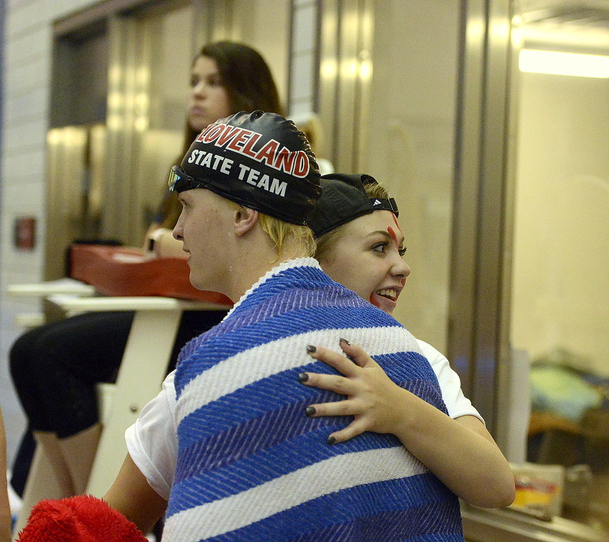 . Loveland\'s Danny Turner gets a hug from his sister Emma after placing sixth in gthe 100-yard breaststroke Saturday at the 4A State Swimming Championships at the Air Force Natatorium.