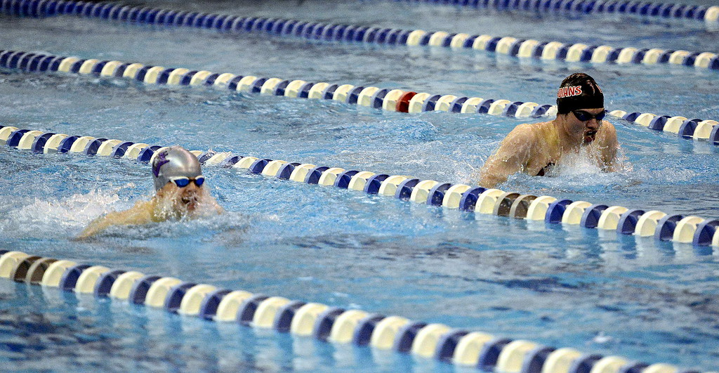 . Loveland\'s Ashton Lyon, right, and Mountain View\'s Matyi Mayo swim in the consolation finals of the 100-yard breaststroke at the 4A State Swimming Championships on Saturday at the Air Force Natatorium. Lyon was 12th, Mayo 13th.