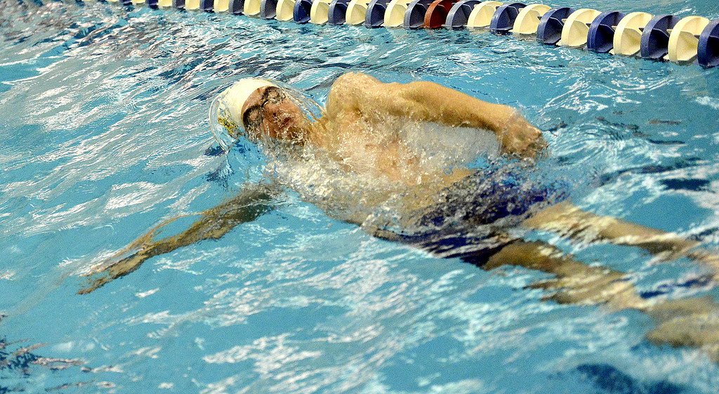 . Thompson Valley\'s Ben Smith breaks the surface for the backstroke leg of the 200-yard individual medley during Saturday\'s finals of the 4A State Swimming Championships at the Air Force Natatorium. Smith placed seventh.